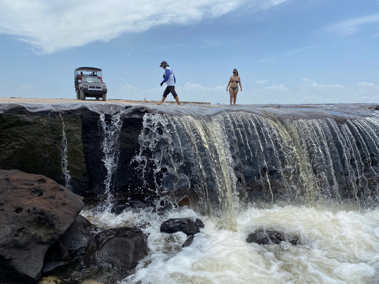 Waterfall on the beach where the Rio Negro fed by the lagoons of the desert pours into the sea...