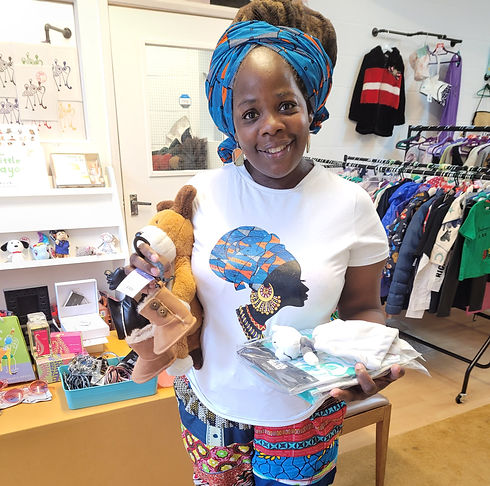 Ngozi in shop with donations_edited.jpg