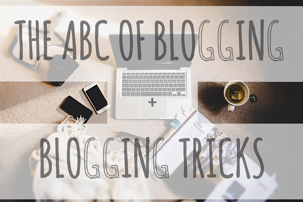 """A laptop with a coffee cup beside with overlapping text """" THE ABC OF BLOGGING + BLOGGING TRICKS"""""""