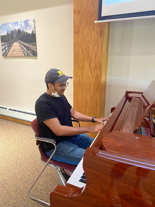 Pierre playing piano at ICCM retreat