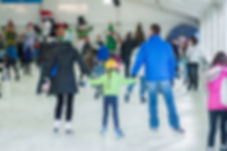 Family skating at the Bellevue Downtown Ice Rink