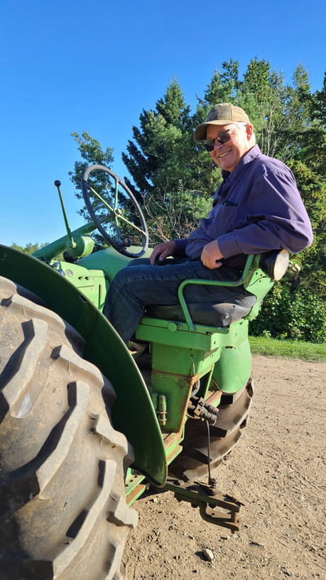 Papa on his antique tractor