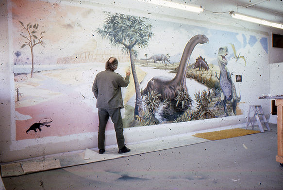 The artist in studio painting a large diorama mural for the Mesa Southwest Museum.