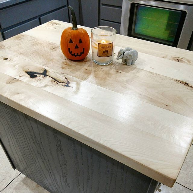 Bleached Maple hardwood kitchen island countertop finished in Waterlox