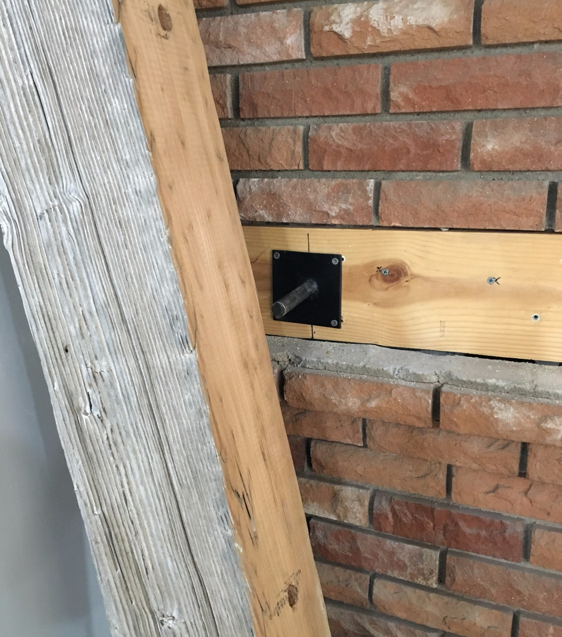 Planed the back side of the beam to sit flush into the red brick gaps.
