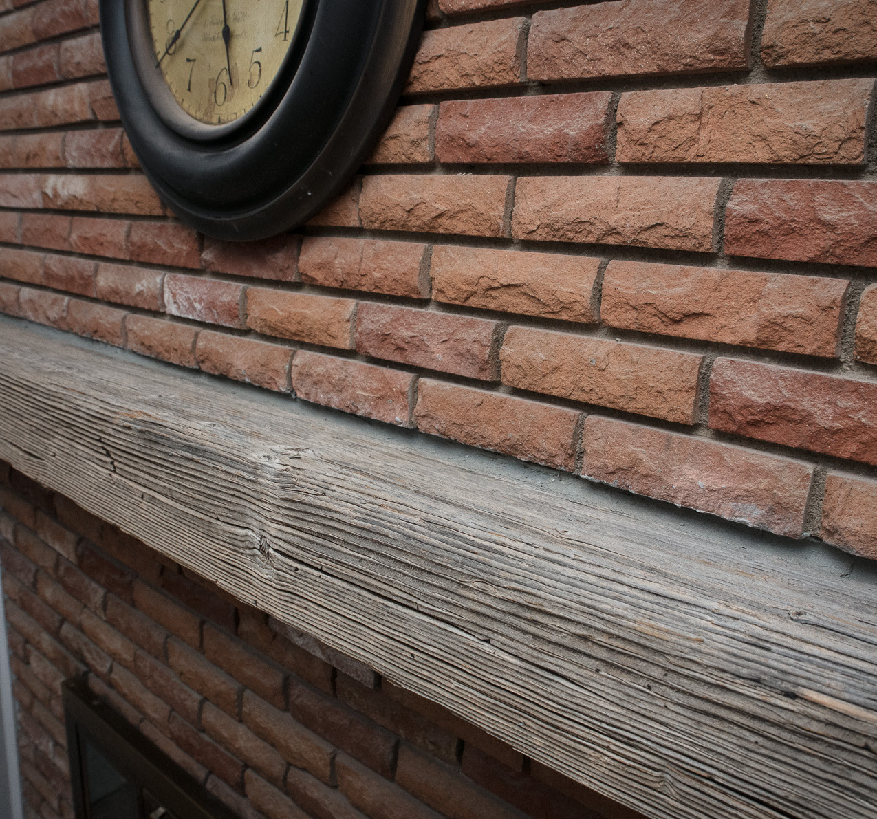 AZ Barnwood mantel beam with red brick fire place in 1955 built home in Arcadia lite