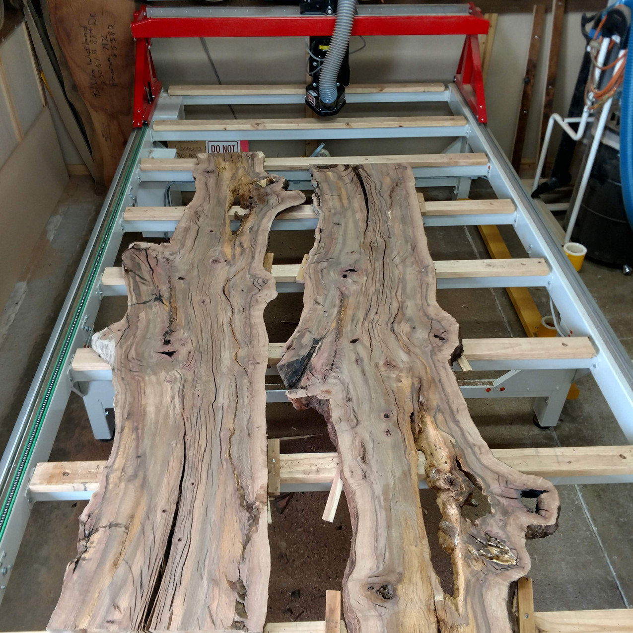 Arizona Black Cherry bookmatched slabs surfaced on the WoodWizz