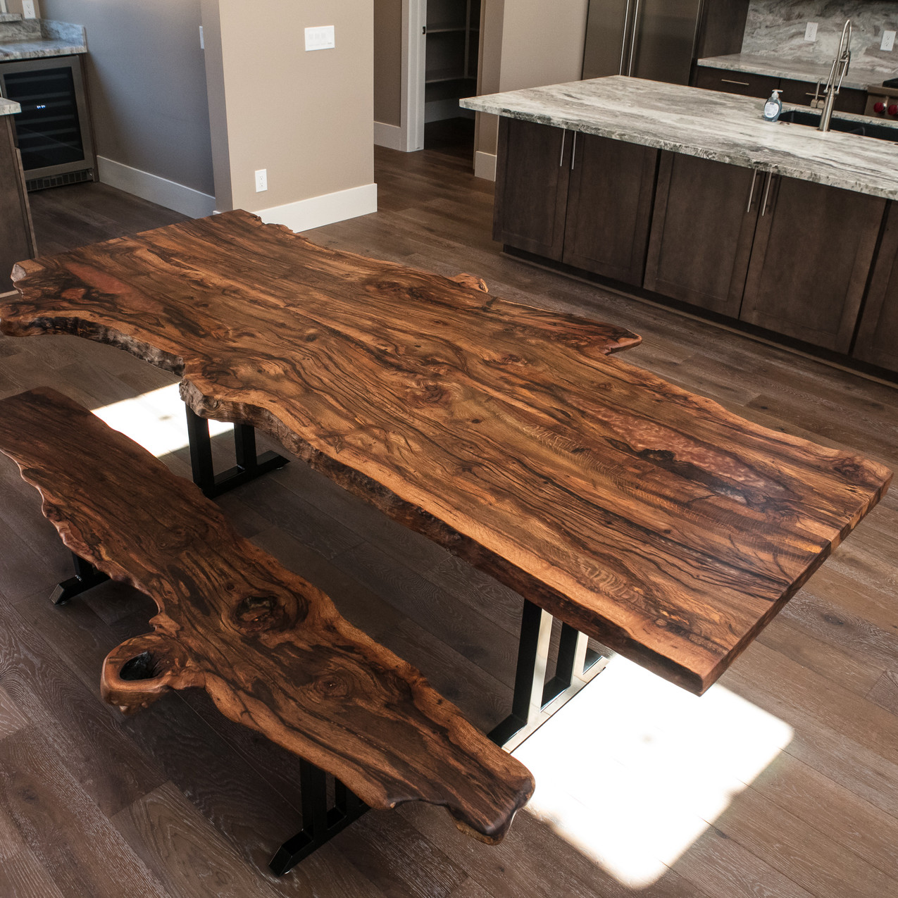 Rustic contemporary live edge dining table made from AZ black cherry slabs reclaimed from Cottonwood area that now reside in our customer's Sedona ranch.