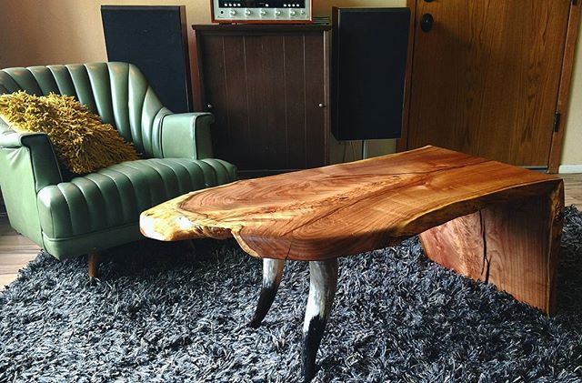 Reclaimed urban lumber live edge mesquite waterfall coffee table with reclaimed polished steer horn legs.