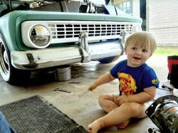 Greasy little boy helping Dad