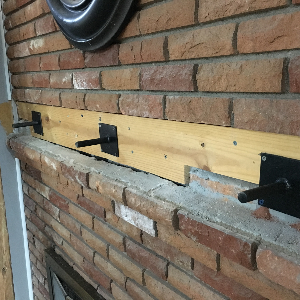 Steel Mantel mounts into wood and mortar backing