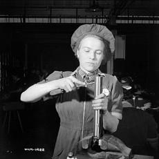 1942_Woman works on carbine_e000760719.j