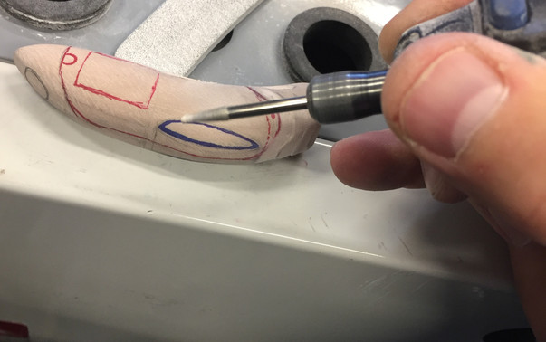 Adding the fine details with a dremel.
