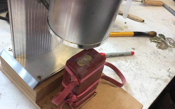 Pouring the metal.