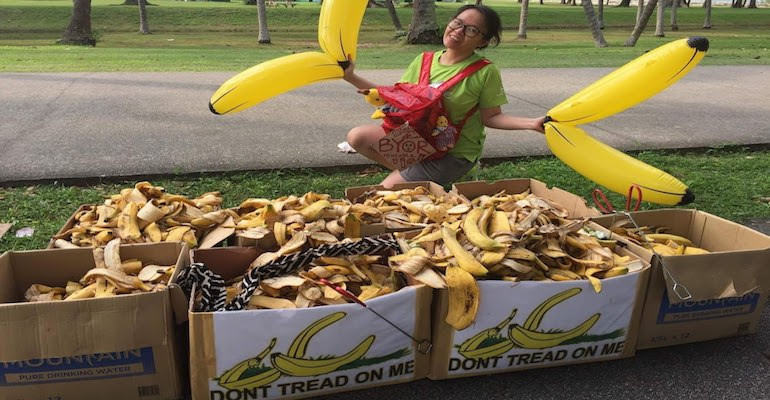 Volunteer overseeing banana peel collection.