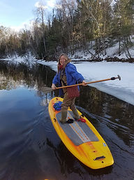 Lynn Upthagrove, Stand Up paddle person who loves doing Yogo on her board too!