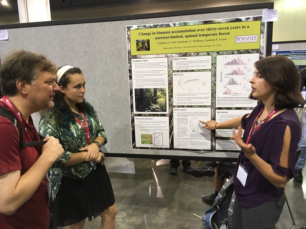 Kimberley explaining poster to Allan Strand (plant ecologist at the College of Charleston).