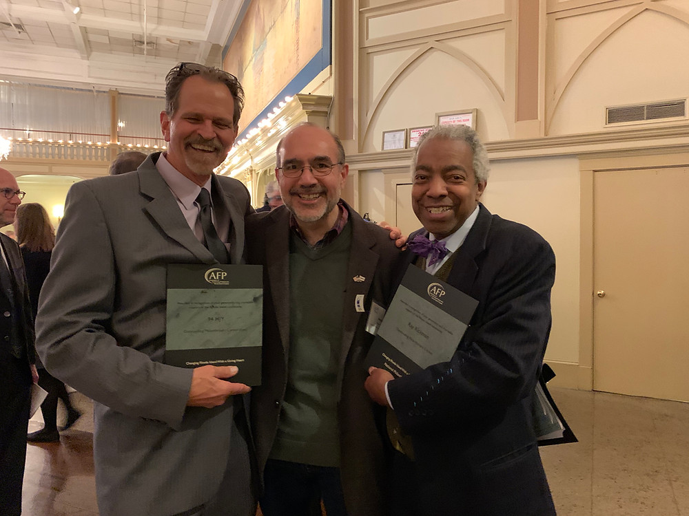 Ray, recipient of the Outstanding Philanthropic Citizenship Award, poses with Steve Fuller of 94 HJY and Pete Cardi