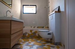 A colourful family bathroom