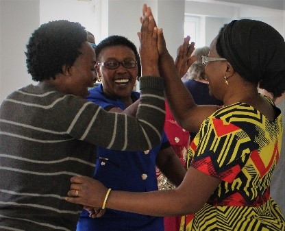 group of women giving high fives