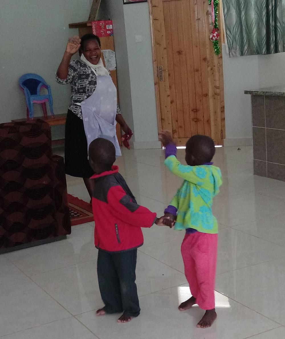 Twins waving goodbye to mom
