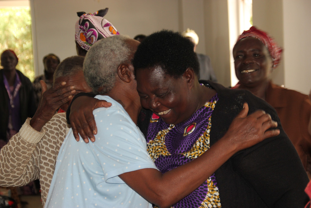 elders hugging