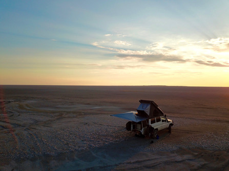 Somewhere in the middle of a salt pan in Botswana we enjoy this beautiful sunset. How lucky are we to experience this?!