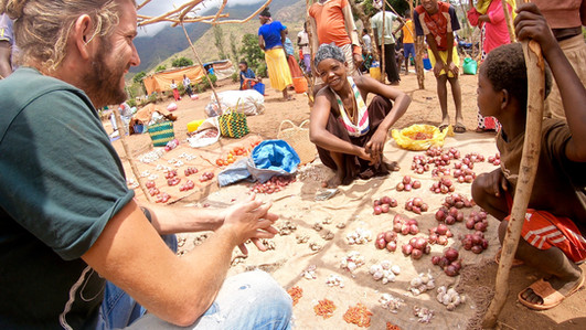 Buying Unions & garlic on the market.