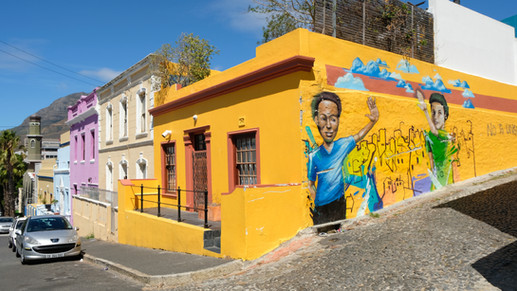Historic area 'Bo-Kaap' that became a home to many Muslims and freed slaves after the abolition of slavery, showcases local Islamic culture. Colourful houses, steep cobbled streets, the muezzin's calls to prayer, and children traditionally dressed for Madrassa.