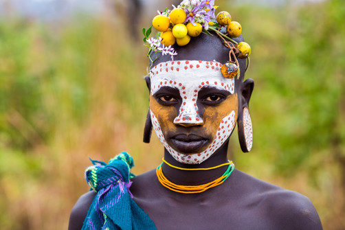 Young Suri Tribe with painted face.