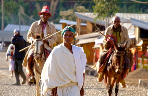 Dorze men on little horses, with a beautiful traditional lady in the front.