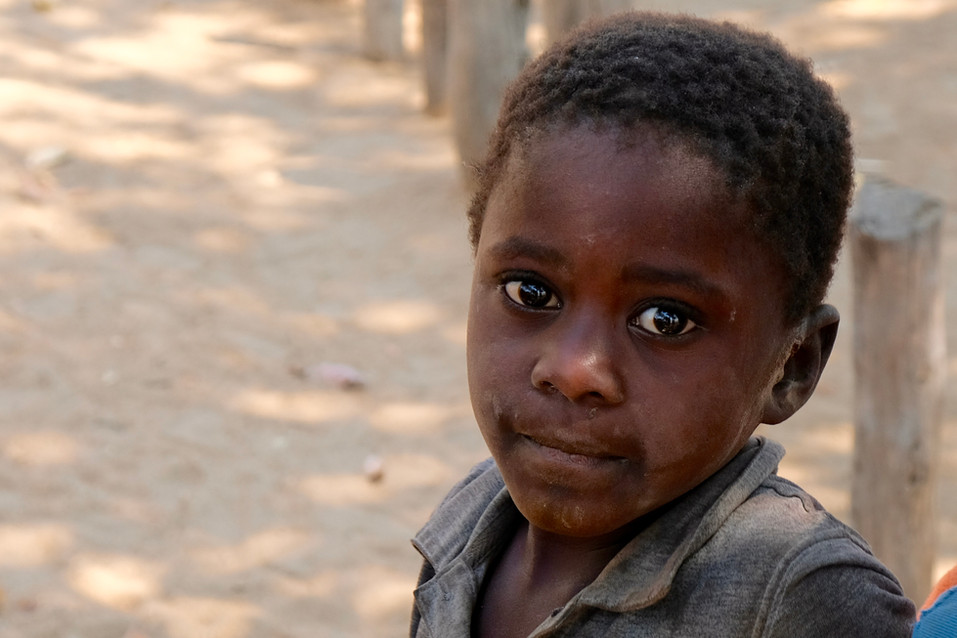 This young boy looked at me with his big brown eyes. He asked me for money. What should you do in this situation?