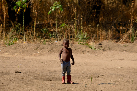 Child with red boots.