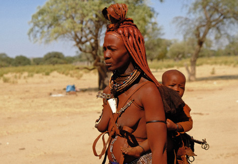 Himba  with child on her back.