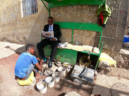 Cleaning your shoes on the street is more then normal here in Ethiopia.