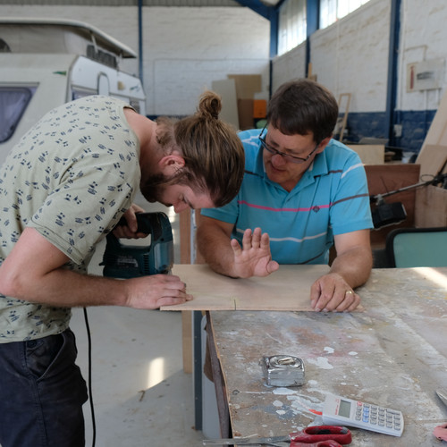 Chris gets lessons with using the power jigsaw.