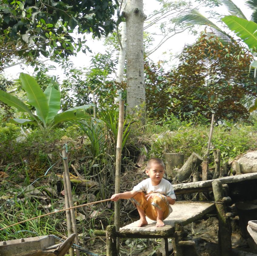 Kind am Mekong