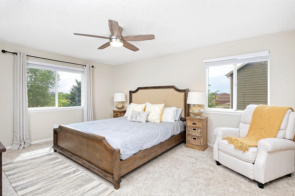 staged primary bedroom slb design co