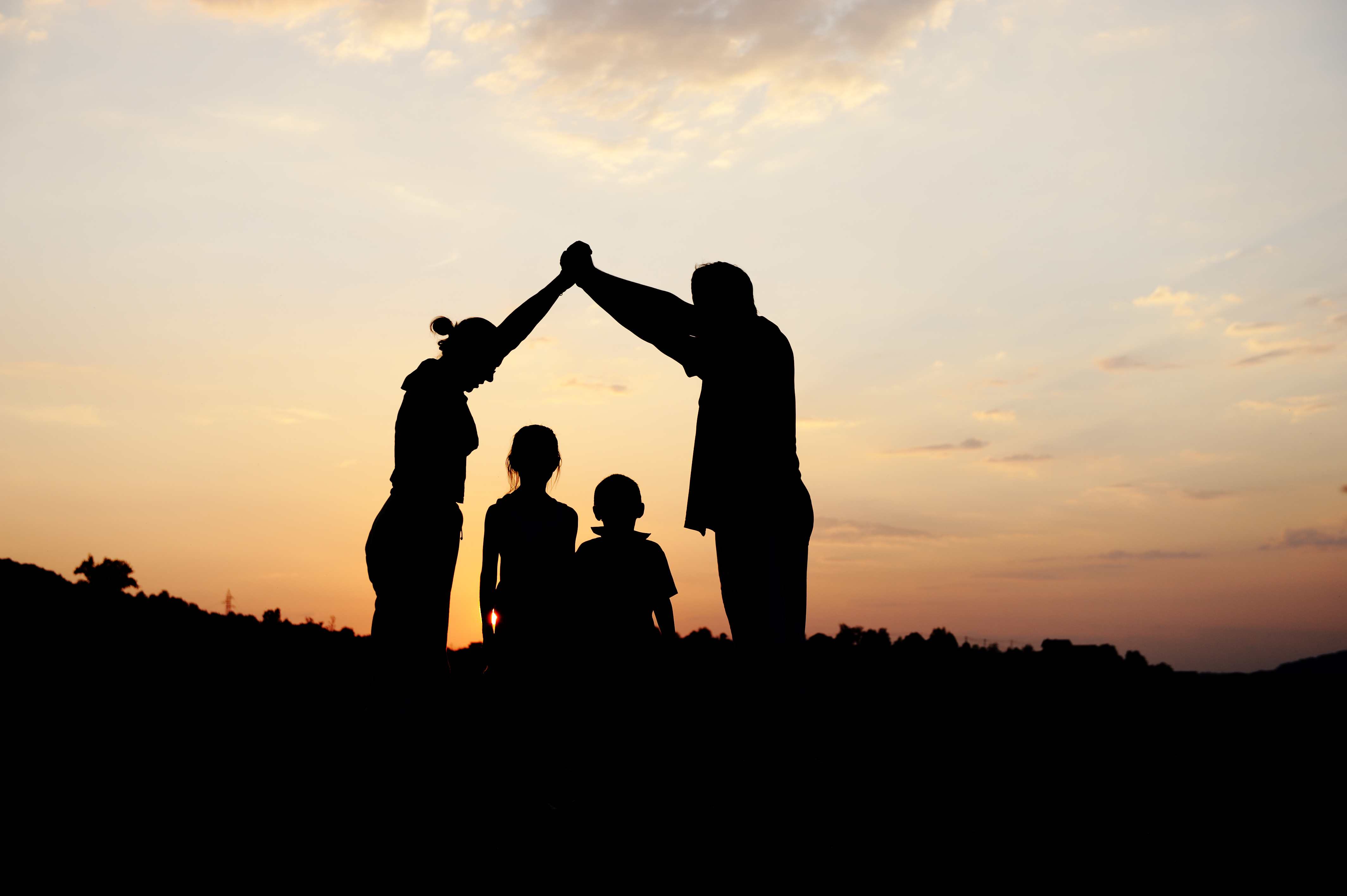 stockfresh_1218734_silhouette-group-of-happy-children-playing-on-meadow-sunset-summertime_sizeXL_55d