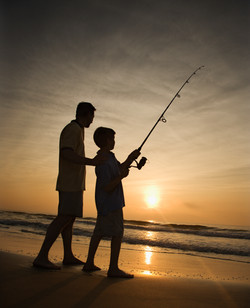 stockfresh_8573_man-and-young-boy-fishing-in-surf_sizeXXL_773732