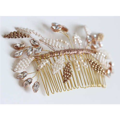 Elegant rose gold and ivory wedding hair comb handcrafted in Cheshire