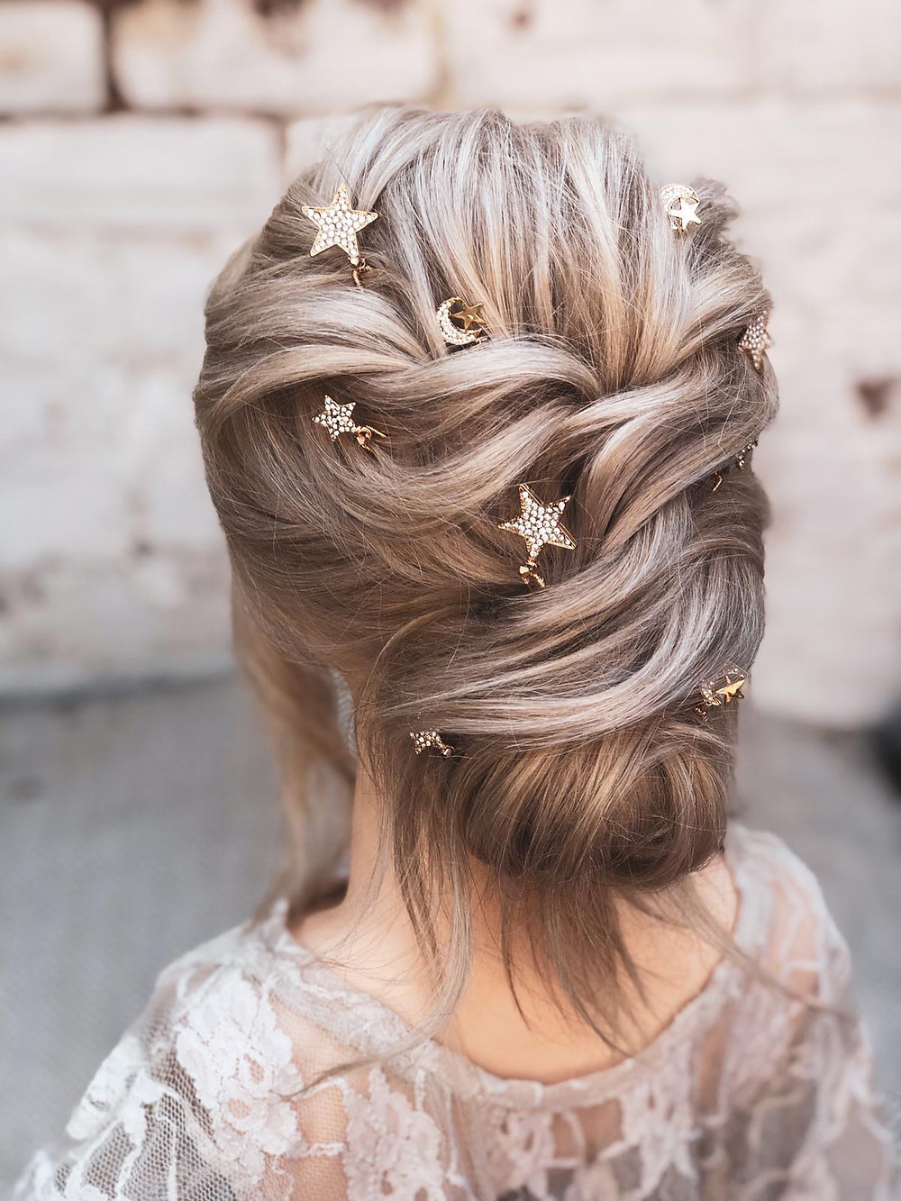 Elegant bridal updo accessorised with moon and stars celestial hair pins