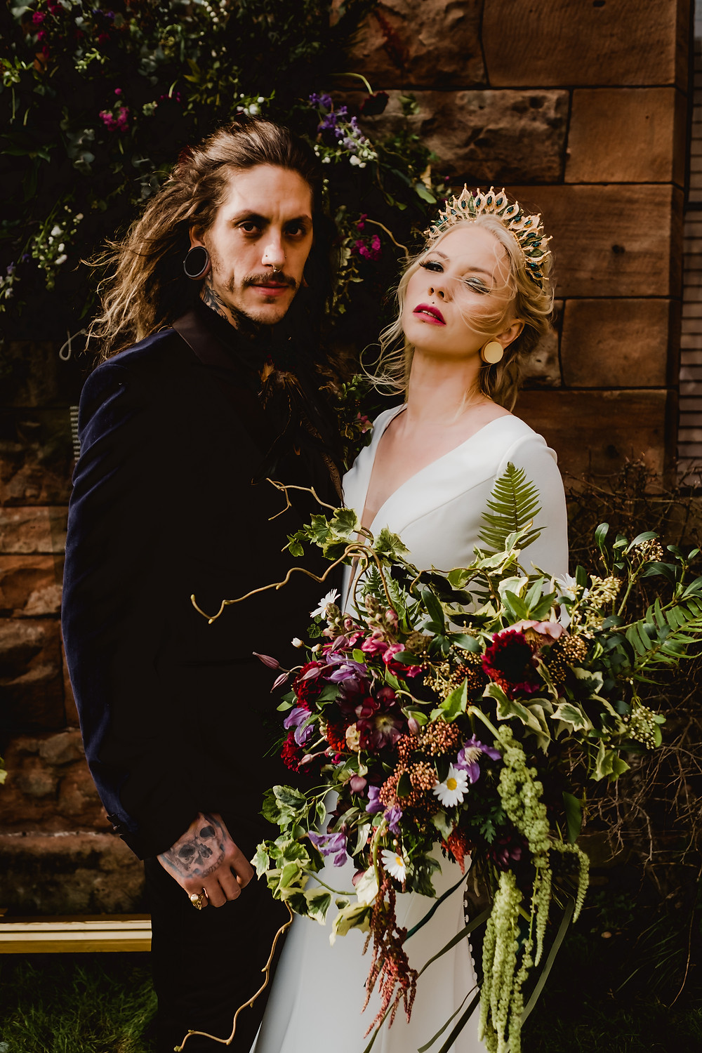 Cool, edgy, tattooed bride and groom. Gothic castle wedding. Bride wears Essence of Australia and a Glorious by Heidi wedding crown.