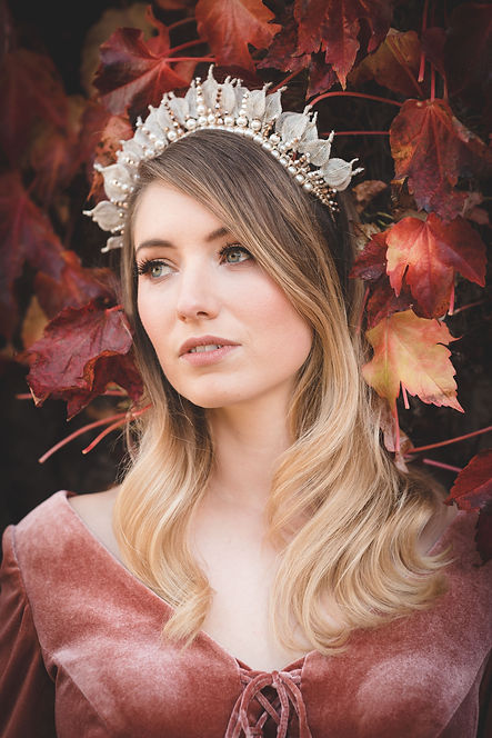 Autumn bride with waves wedding hairstyle wearing a gold statement bridal crown