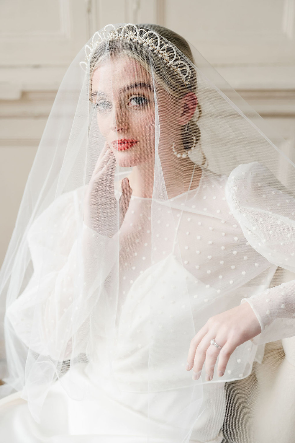Bride wearing a drop veil over her ivory and gold wedding crown designed by Glorious by Heidi in Cheshire, UK