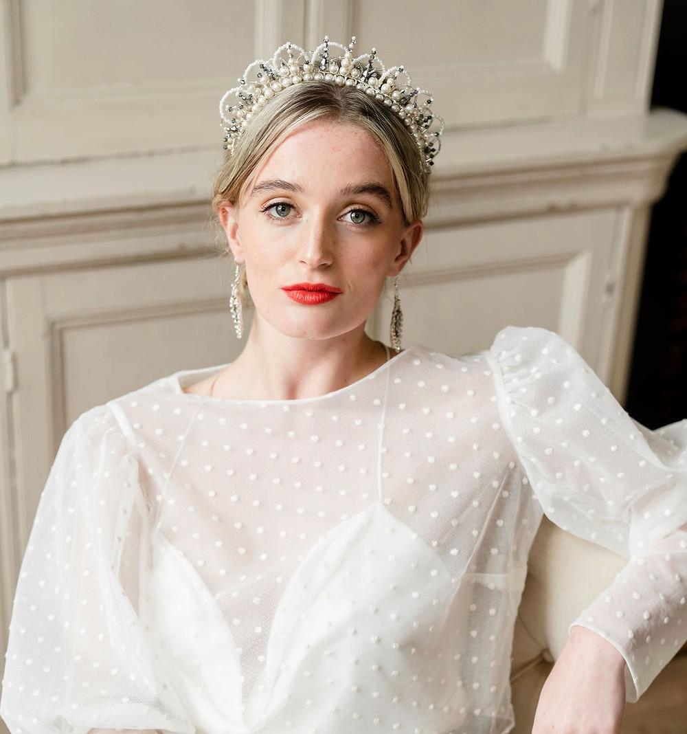 Elegant bride wearing a modern pearl and silver wedding crown