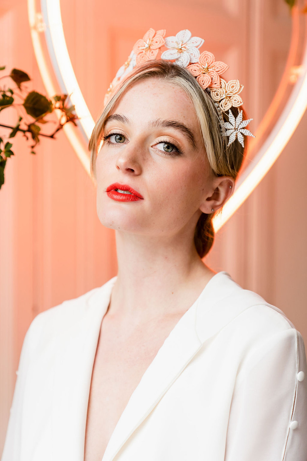 Cool, modern bride wears a hand beaded flower crown in peach, baby blue and sandstone colours, designed by wedding accessory designer Glorious by Heidi in Cheshire, UK