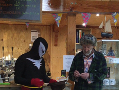 Puffin Man draws the raffle.PNG