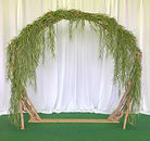 stick arch with greenery.jpeg
