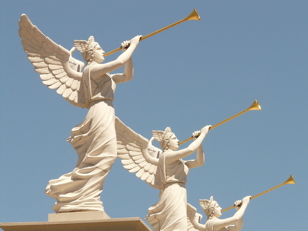 Three angels blowing the trumpets representing the blowing of the trumpets at the second coming of Christ.